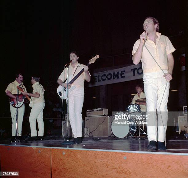 Rock and roll band 'The Beach Boys' perform onstage in the summer of 1964 with Fender amplifiers and guitars Carl Wilson Al Jardine Brian Wilson...