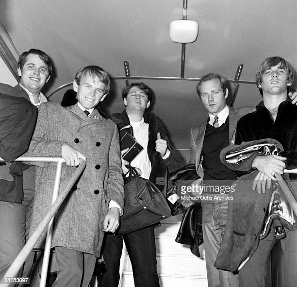 Rock and roll band 'The Beach Boys' pose for a portrait as they prepare to disembark from a plane Carl Wilson Al Jardine Brian Wilson Mike Love and...