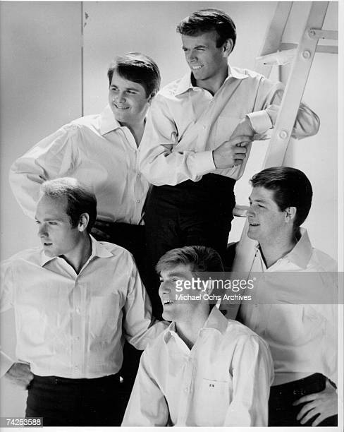 Rock and roll band 'The Beach Boys' pose for a portrait in 1964 Clockwise from bottom left Mike Love Carl Wilson Al Jardine Brian Wilson Dennis Wilson