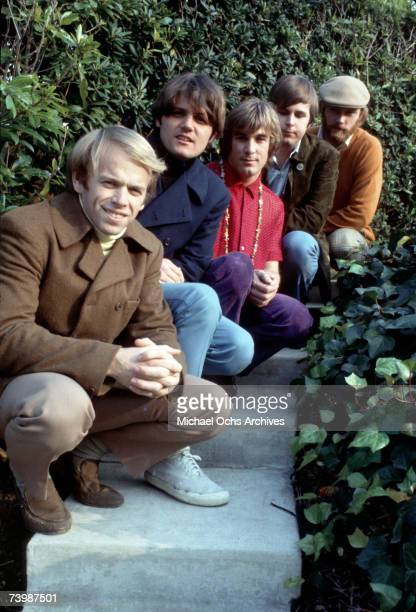 Rock and roll band 'The Beach Boys' pose for a portrait kneeling down on some steps in circa 1966 Al Jardine Bruce Johnston Dennis Wilson Carl Wilson...