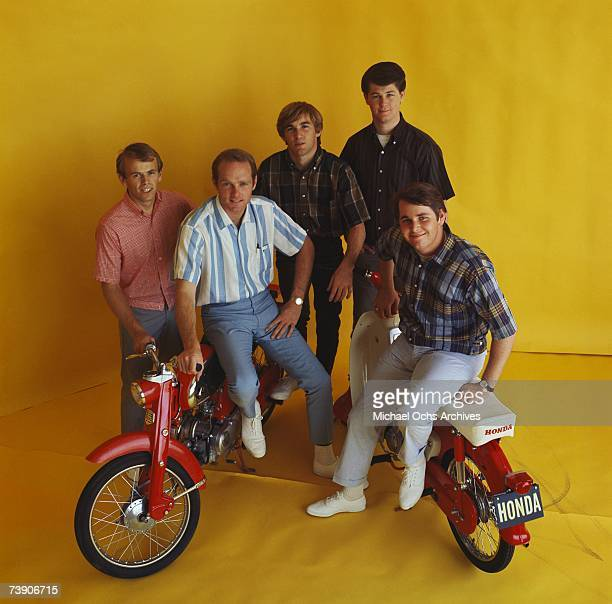 Rock and roll band 'The Beach Boys' pose for a portrait with 2 Honda Mopeds in circa 1964 in Los Angeles California Al Jardine Mike Love Dennis...