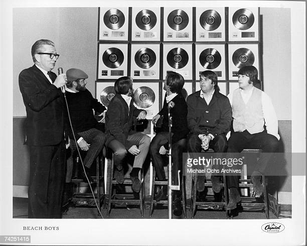 Rock and roll band 'The Beach Boys' poses for a portrait in front of a wall full of their gold records in November 1965 Mike Love Al Jardine Dennis...