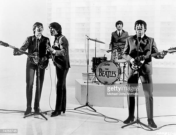Rock and roll band 'The Beatles' perform on a TV show in 1963
