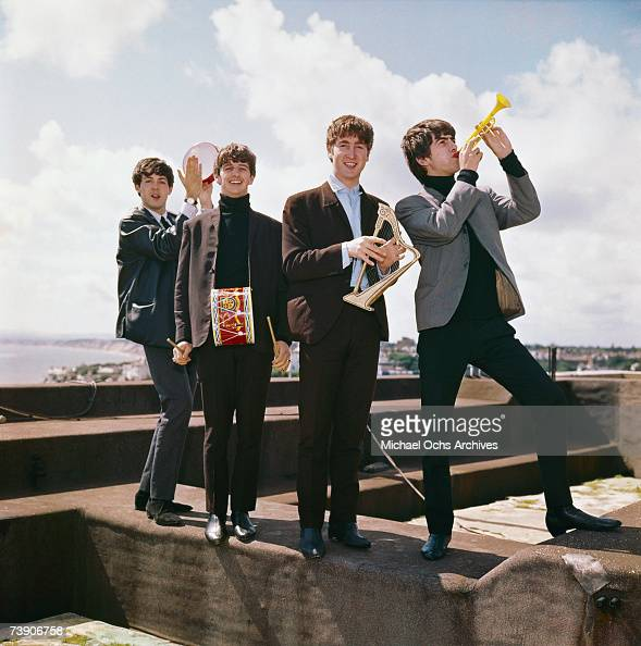 Rock and roll band 'The Beatles' pose for a portrait in circa 1964 in England George Harrison John Lennon Ringo Starr Paul McCartney