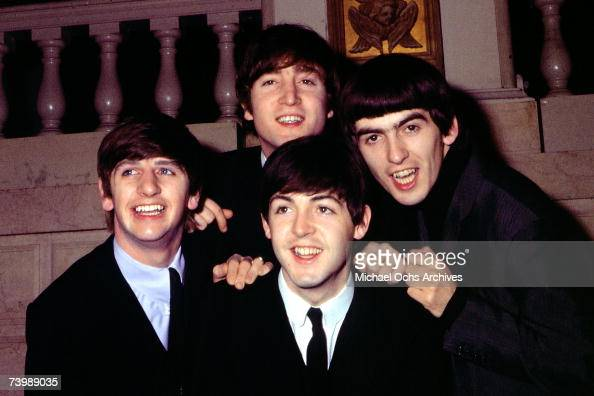 Rock and roll band 'The Beatles' pose for a portrait wearing suits in circa 1964 Ringo Starr John Lennon Paul McCartney George Harrison