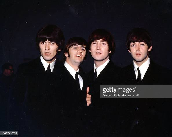 Rock and roll band 'The Beatles' pose for a portrait wearing suits in 1964 George Harrison Ringo Starr John Lennon Paul McCartney