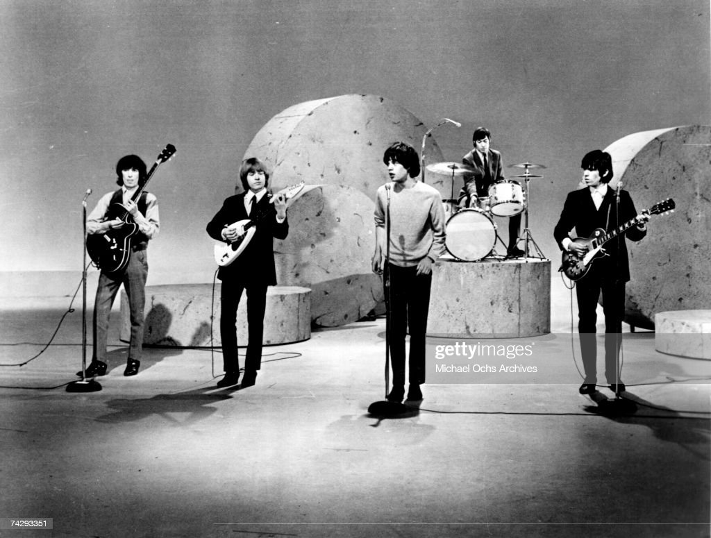 Rock and roll band 'The Rolling Stones' perform on the Ed Sullivan Show on October 25 1964 in New York City New York Bill Wyman Brian Jones Mick...