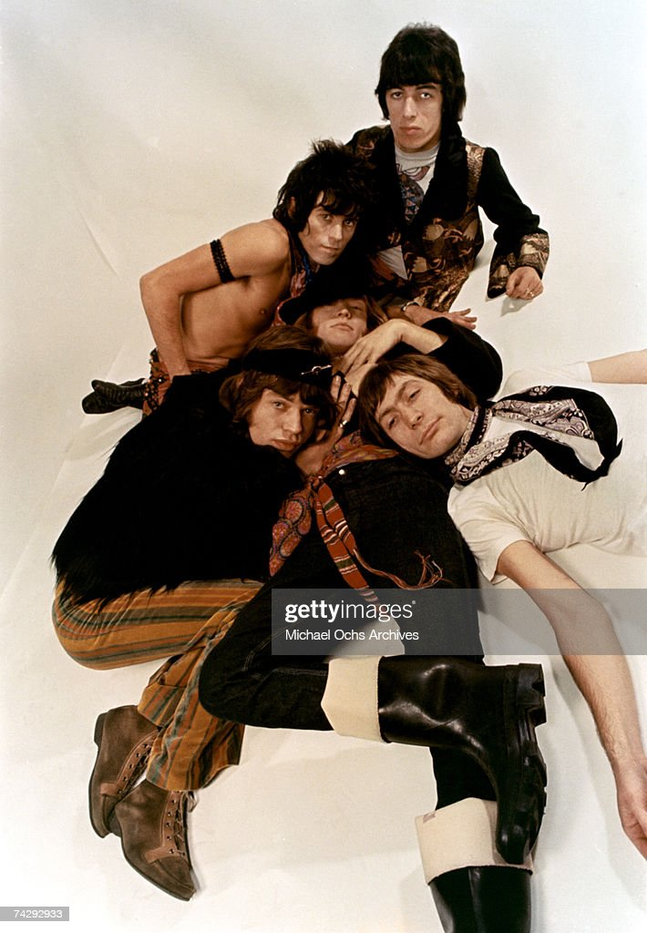 Rock and roll band 'The Rolling Stones' pose for a portrait lying down Mick Jagger Keith Richards Bill Wyman Charlie Watts Brian Jones