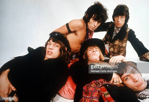Rock and roll band 'The Rolling Stones' pose for a portrait lying down Keith Richards Bill Wyman Charlie Watts Brian Jones Mick Jagger