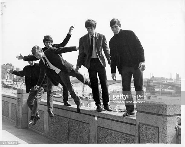 Rock and roll band 'The Rolling Stones' poses for a portrait jumping off a railing in 1965 Bill Wyman Brian Jones Keith Richards Mick Jagger Charlie...