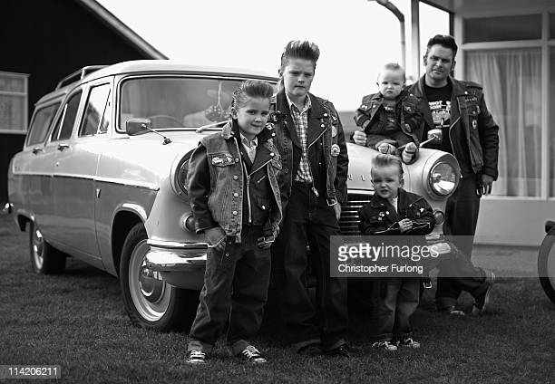 Rock and Roll devotee Dave Monger poses with his children Billy Lee aged one Eddie three Buddy eight and Gerry lee aged 10 during the Hemsby Rock n...