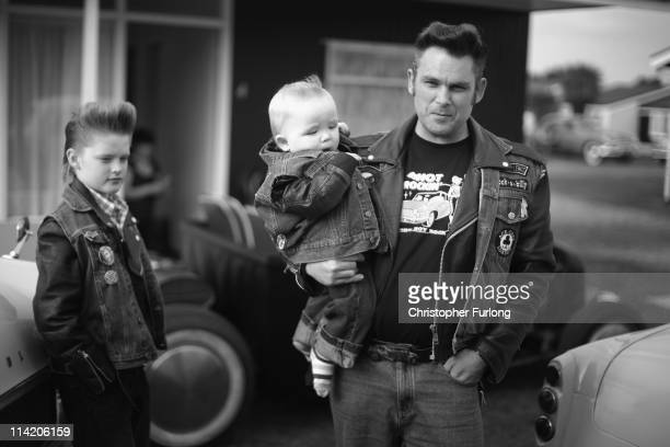 Rock and Roll devotee Dave Monger poses with his sons Billy Lee aged one and Gerry lee aged 10 during the Hemsby Rock n Roll Weekender on May 15 2011...