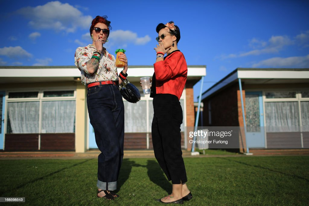 Rock and Roll devotees Lori Barker (L) and Yvette Hillebrandt pose as they attend the 50th Hemsby Rock 'n' Roll Weekender as the biannual festival celebrates 25 years on May 12, 2013 in Hemsby, England. Fans of Rock and Roll, Rockabilly, Rockin' Blues and Americana gather at Seacroft Holiday Camp in Hemsby to dress up in period clothing and re-live the 1940's and 50's. Every day of the four day 'weekender' a line up of top live bands play the music of the era and devotees hit the dance floor to hop, bop, jive and Rock 'n' Roll.
