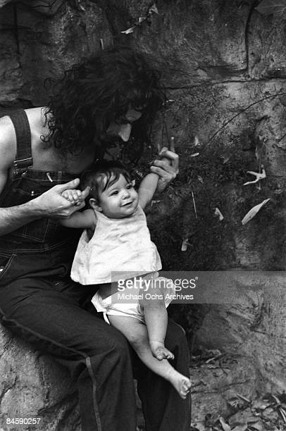 Rock and roll guitariist Frank Zappa poses for a portrait in Laurel Canyon with his daughter Moon Unit Zappa in February 1968 in Los Angeles...