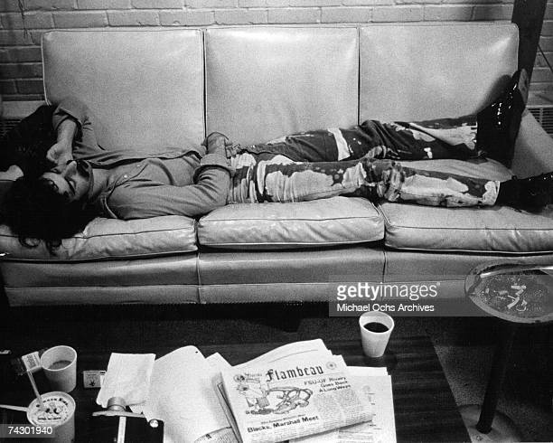 Rock and roll guitarist Frank Zappa lies down on a sofa in 1968 in Los Angeles California