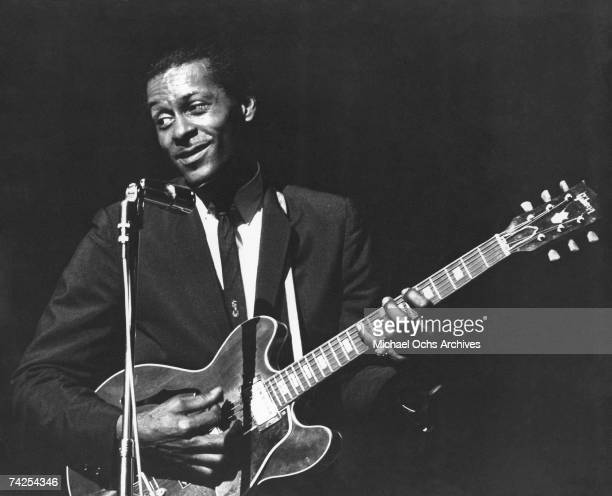 Rock and roll musician Chuck Berry performs onstage with his Gibson hollowbody electric guitar in circa 1965