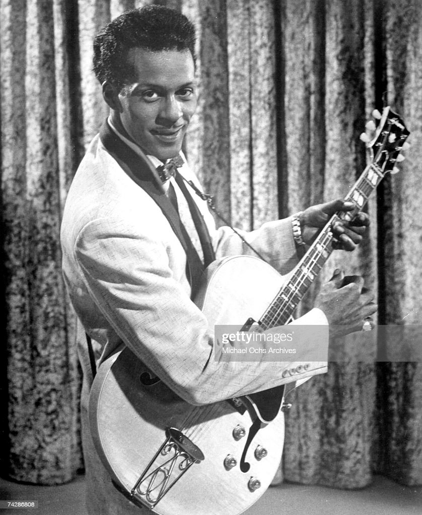 Rock and roll musician Chuck Berry poses for a portrait holding a Gibson hollowbody electric guitar in a scene from the movie 'Go Johnny Go' which was released in June of 1959 in Los Angeles, California.