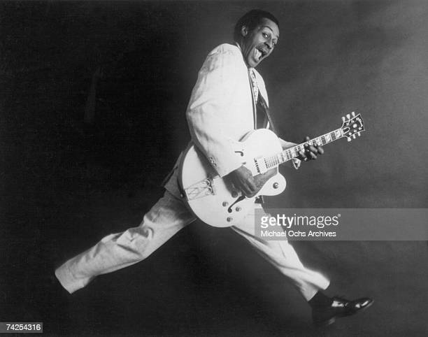 Rock and roll musician Chuck Berry poses for a portrait holding his Gibson hollowbody electric guitar in circa 1958