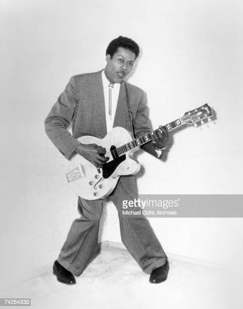 Rock and roll musician Chuck Berry poses for a portrait holding his Gibson hollowbody electric guitar in circa 1956