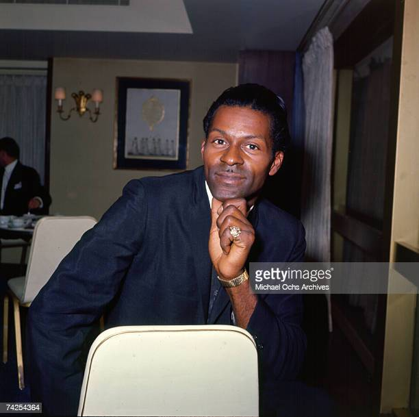 Rock and roll musician Chuck Berry poses for a portrait session in a hotel in circa 1958