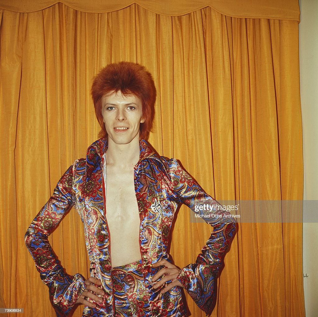 Rock and roll musician David Bowie poses for a portrait dressed as 'Ziggy Stardust' in a hotel room in 1973 in New York City, New York.