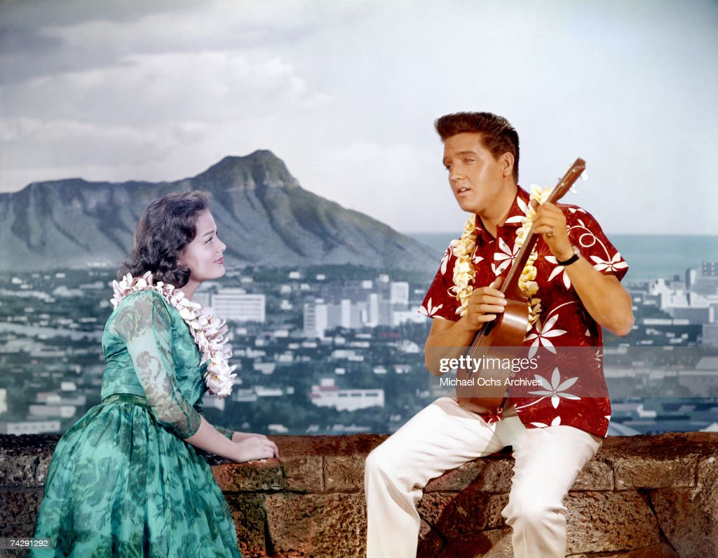 Rock and roll singer and actor Elvis Presley in a movie still with a woman on the set of 'Blue Hawaii' at Paramount Pictures in April of 1961 in Los Angeles, California.