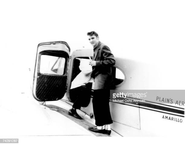 Rock and roll singer Elvis Presley boards a plane headed to Memphis Tennesee on April 14 1956 in Nashville Tennessee Use information