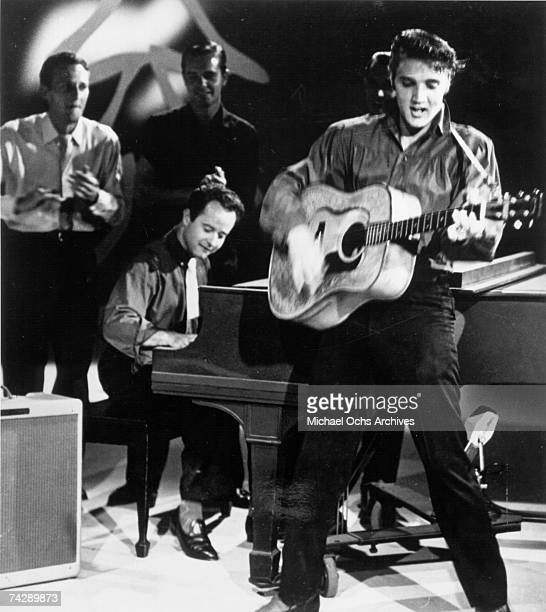 Rock and roll singer Elvis Presley performs on the Ed Sullivan show on September 9 1956 at CBS Studios in Los Angeles California