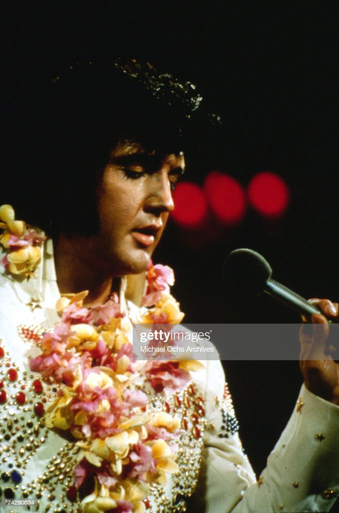 Rock and roll singer <a gi-track='captionPersonalityLinkClicked' href=/galleries/search?phrase=Elvis+Presley&family=editorial&specificpeople=67209 ng-click='$event.stopPropagation()'>Elvis Presley</a> performs onstage at the International Convention Center in Honolulu Hawaii on January 14 1973.