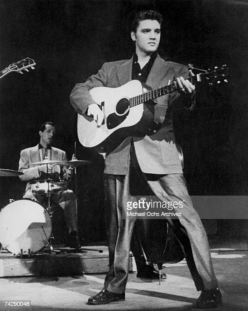 Rock and roll singer Elvis Presley performs 'Tutti Frutti' and 'Baby Let's Play House' on the Dorsey Brothers' radio show on February 4 1956 in New...