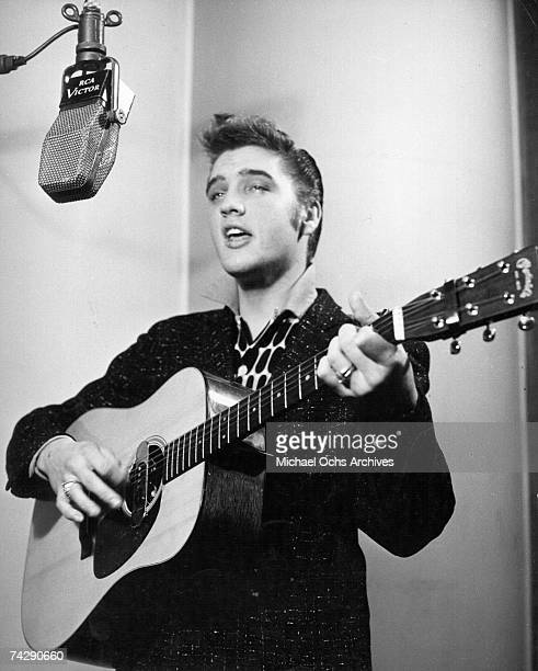 Rock and roll singer Elvis Presley recording in an RCA Victor studio in 1956