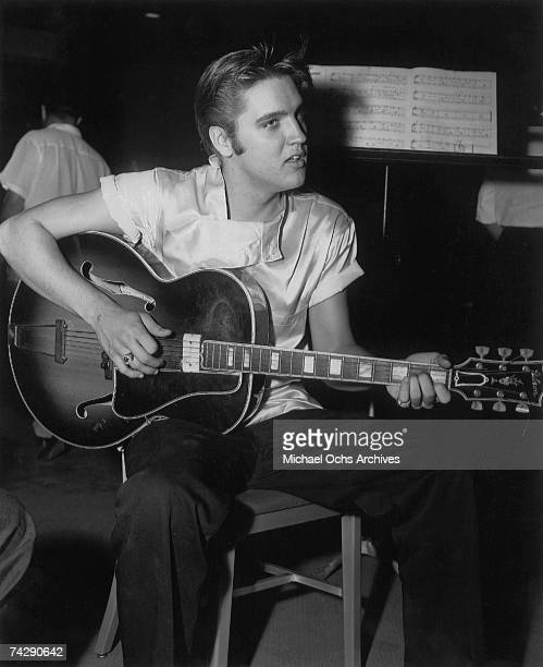 Rock and roll singer Elvis Presley records the soundtrack for his film 'Love Me Tender' in RCA Studios on August 4 1956 in Los Angeles CA