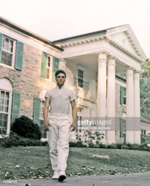 Rock and roll singer Elvis Presley strolls the grounds of his Graceland estate in circa 1957