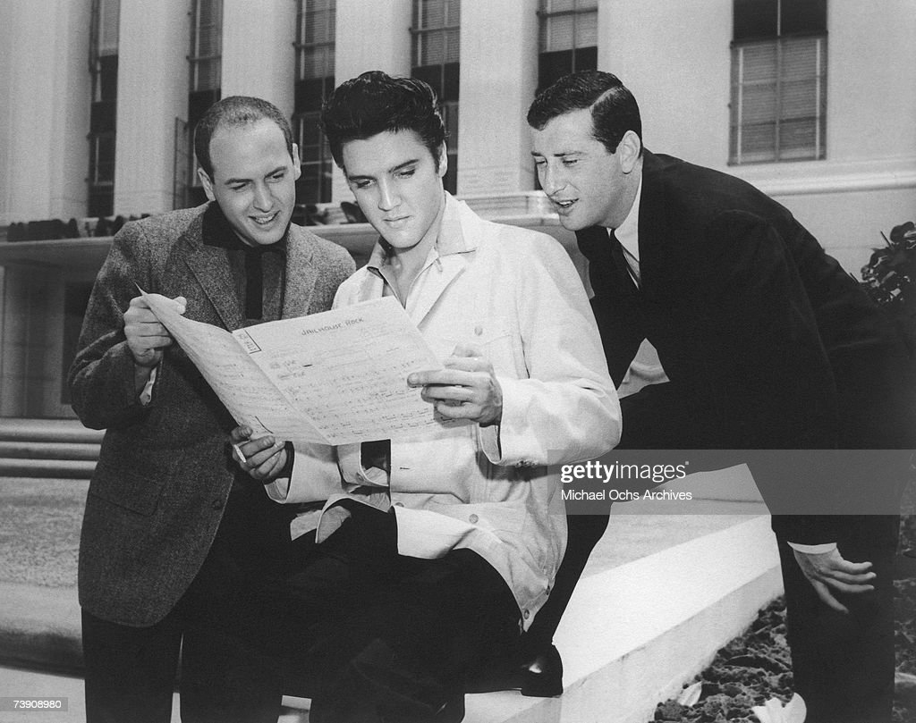 Rock and roll singer Elvis Presley with songwriters Leiber and Stoller looking over the sheet music for Jailhouse Rock at Metro-Goldwyn-Mayer Studios in 1957 in Culver City, California. (L-R) Mike Stoller, Elvis Presley, Jerry Leiber.