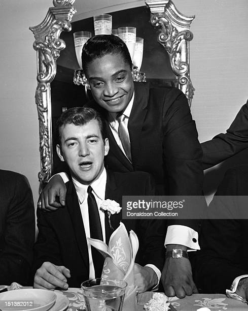 Rock and roll singer Jackie Wilson and singer Bobby Darin at a dinner for the Motion Picture Pioneers Association at the Playboy Club on November 19...