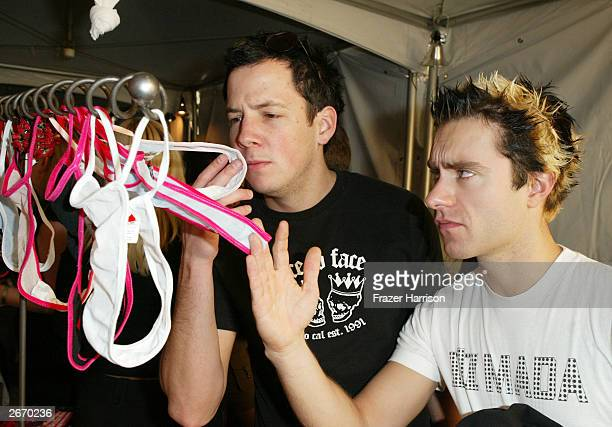 Rock artists 'Simple Plan' sniff the Thong 'n Cheek lingerie display at the 2003 Tall Pony Radio Music Awards gift lounge outside the Aladdin Hotel...