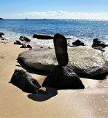 Rock balancing is different from rock stacking.  Rock balancing is a fun thing to do with a few rocks found in the general area and takes patience.  It uses fewer rocks and doesn't upset the natural l