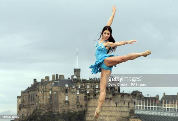 Rock Ballet performer Jordan Hombardi performs leaps and dance moves on a roof terrace in front of Edinburgh Castle ahead of her festival show using...