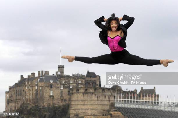 Rock Ballet performer Kamille Upshaw performs leaps and dance moves on a roof terrace in front of Edinburgh Castle ahead of her festival show using...