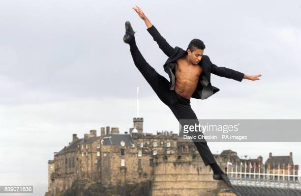 Rock Ballet performer Lee Gumbs perform leaps and dance moves on a roof terrace in front of Edinburgh Castle ahead of his festival show using ballet...