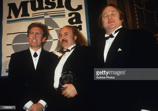 Rock band Crosby Stills Nash with their Music Cares award 1990s From left to right Graham Nash David Crosby and Stephen Stills