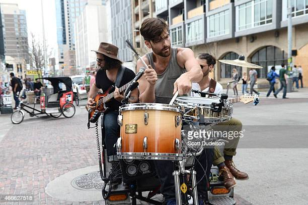 Rock band Eyes on the Shore perform in a pedicab on 6th street on March 17 2015 in Austin Texas