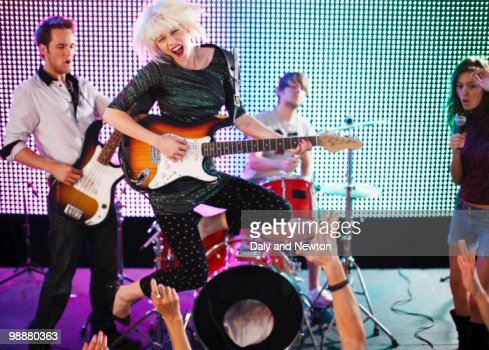 Rock band performing on stage : Stock Photo
