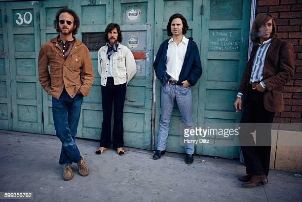 guitarist Robbie Krieger drummer John Densmore singer Jim Morrison and keyboardist Ray Manzarek The writing between Morrison and Manzarek reads 'I...