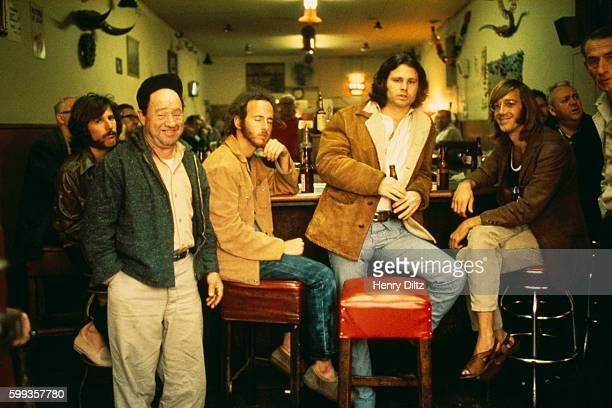 Rock band the Doors barside at the Hard Rock Cafe in Los Angeles The Doors are drummer John Densmore guitarist Robbie Krieger singer Jim Morrison and...