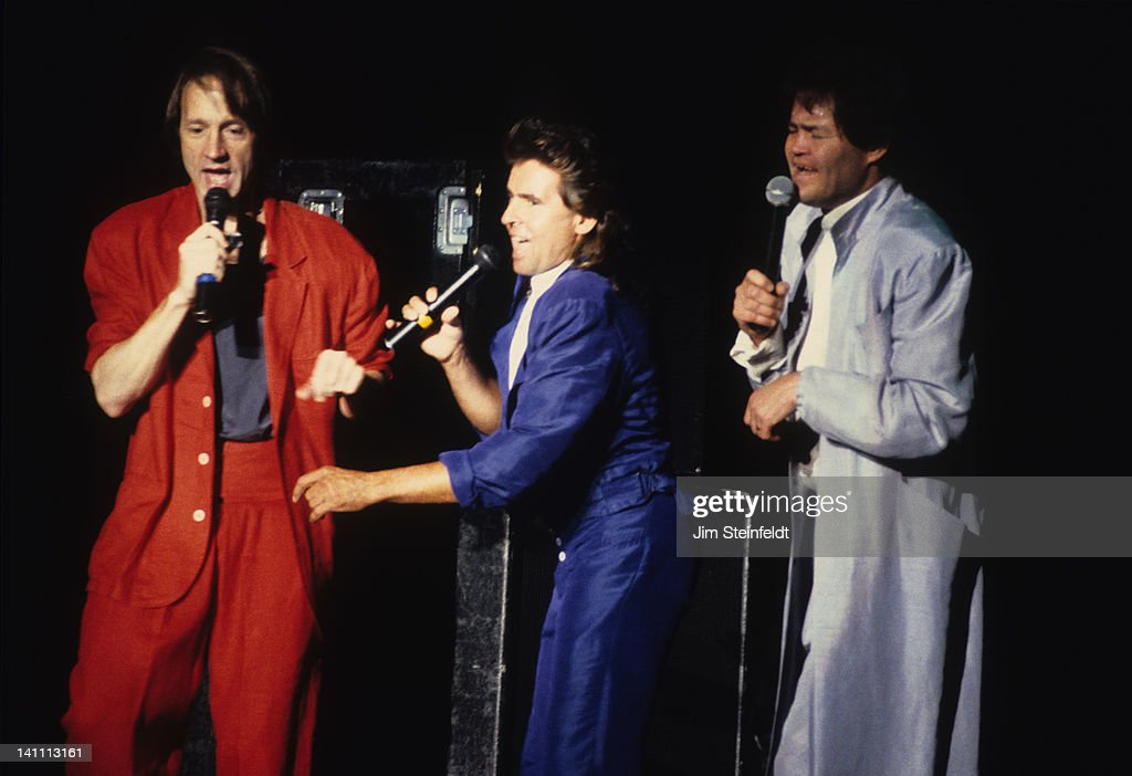 Rock band the Monkees Peter Tork Davy Jones and Micky Dolenz perform at the Carlton Dinner Theatre in Bloomington Minnesota in August 1986