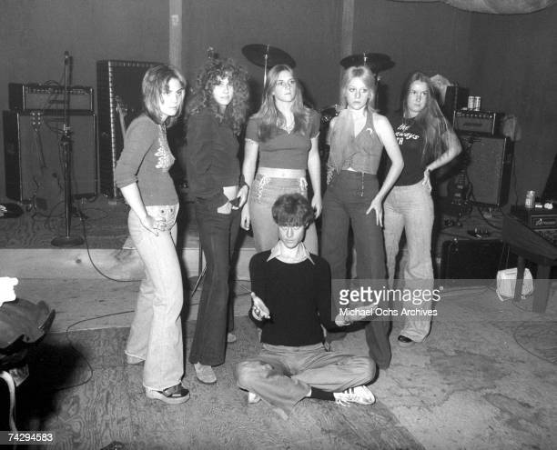 Rock band 'The Runaways' pose for a portrait with their producer Kim Fowley in Los Angeles in 1975 Joan Jett Peggy Foster Sandy West Cherie Currie...