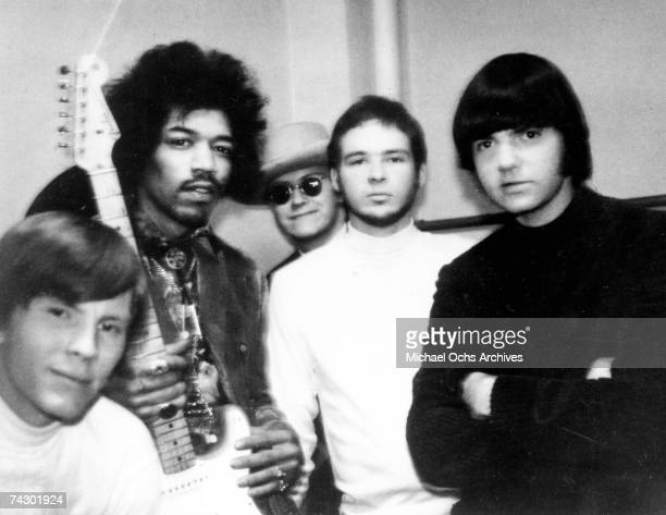 Rock band 'ZZ Top' formerly 'The Moving Sidewalks' poses for a portrait with rock guitarist Jimi Hendrix whom they opened for at the Municipal...