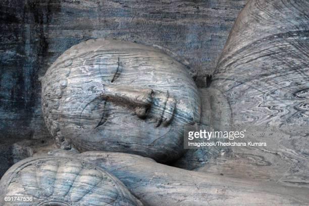 Rock carving of reclining Budddha