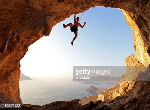 Rock climber at sunset : Stock Photo